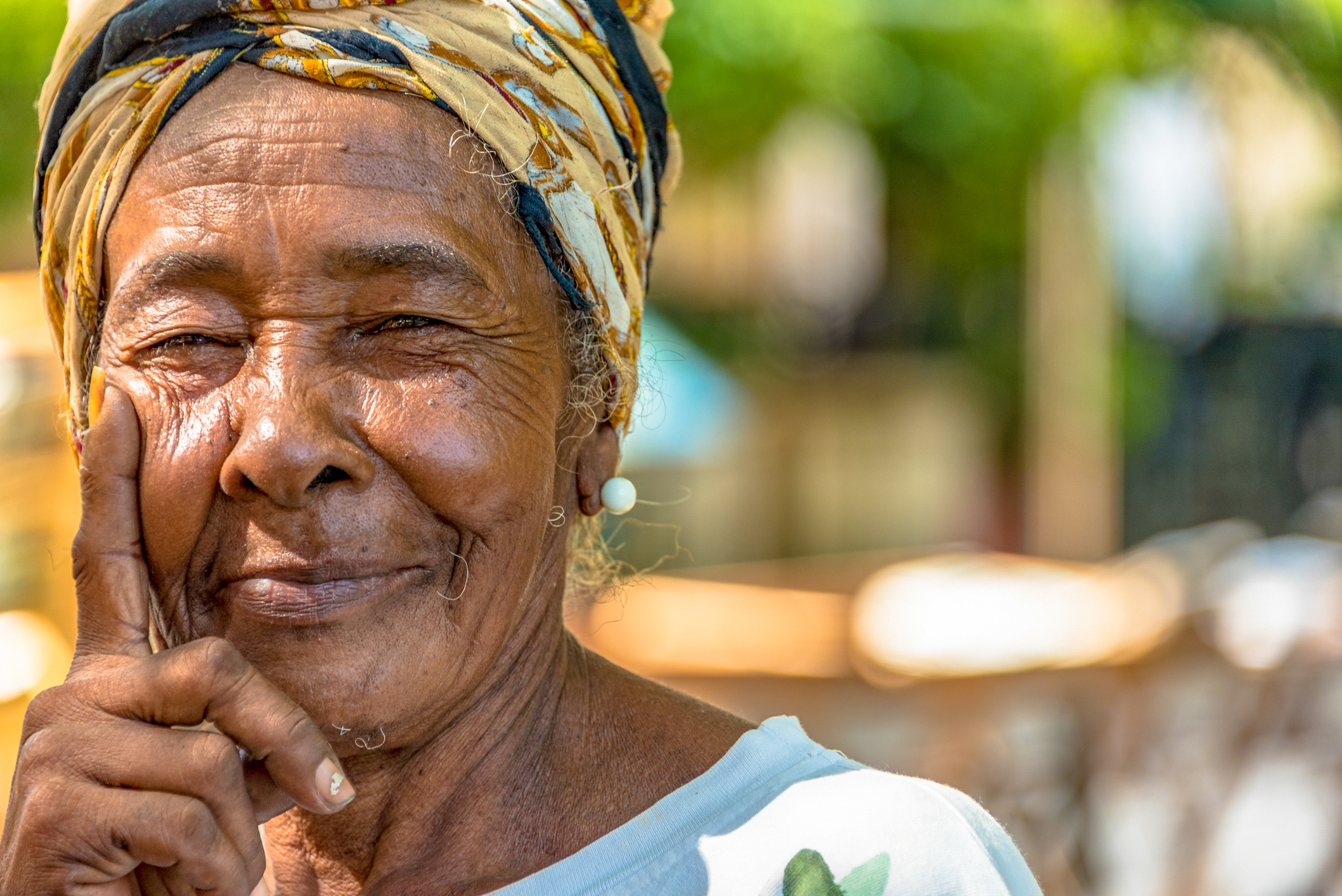 Cuban Afro Caribbean woman in Old Havana. People are friendly and an attraction to photographers. Old Havana is a Unesco World Heritage Site